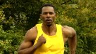 Athletic Man Runs Toward Camera - Deep Focus video