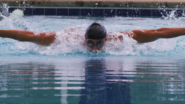 Athletic swimmer in a race video