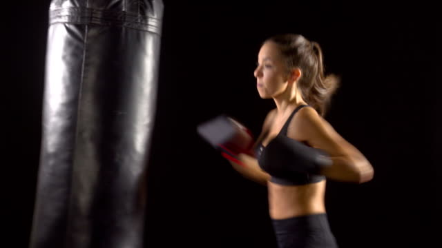 Athletic Woman Boxing Punching-Bag video