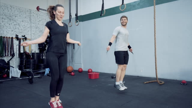 Athletic young couple jumprope workout. video