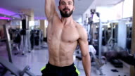 Athletic Young Male Does Dumbbell Exercises at Gym video