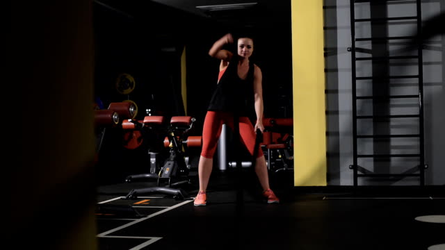Athletic young woman doing some gym exercises with a rope video
