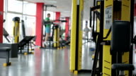 Atmosphere in fitness club, many active people exercising on sports video