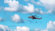 Attack helicopter Mi-24 flying on a background of clouds. Included audio video