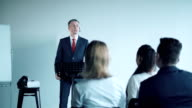 Attentive young audience in a business meeting video