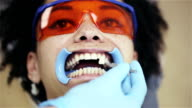 Attractive african american woman patient in a dental clinic video