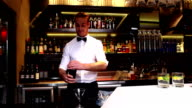 Attractive bar man making a cocktail video