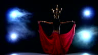 Attractive belly dancer girl continue dancing with candles on her head, black, smoke video