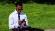 Attractive black businessman on the phone at lauch break video