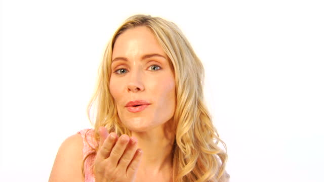 Attractive Blond Woman Blows a Kiss then Waves video