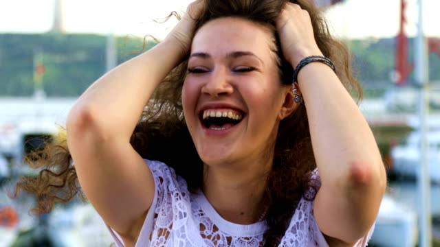 Attractive brunette smiling at camera video