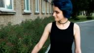 Attractive, confident Molodan girl walks through the city video