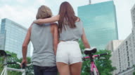 Attractive couple on a bike ride video