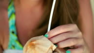 Attractive couple toasting with coconut, exotic vacations video