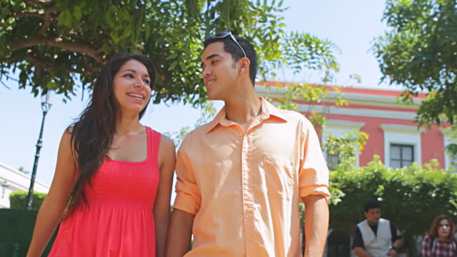 Attractive couple walking in city video