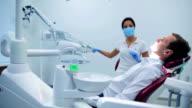 Attractive dentist preparing to work with patient video