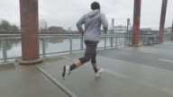 Attractive ethnic male exercising/running outdoors video
