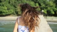 Attractive Female Running Pier Ocean Beach Slow Motion video