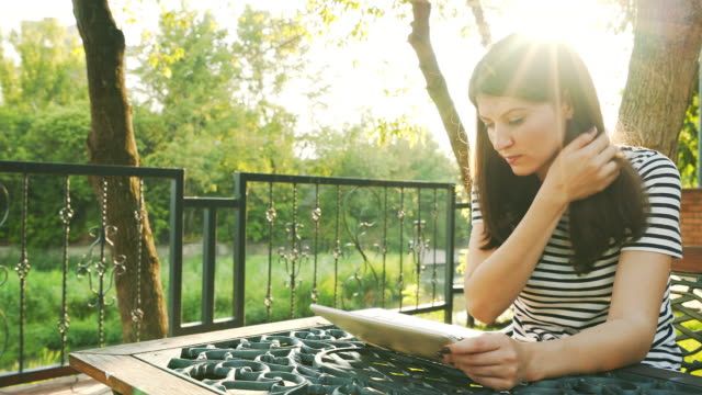 Attractive female using a digital tablet. video