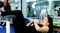 attractive girl athlete engaged in exercises on work abdominal, the press shakes, Woman doing press on mat in gym video