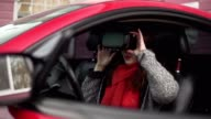 Attractive girl in virtual reality glasses in the car. video