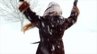 attractive girl playing in the snow video