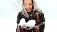 attractive girl plays with snow video