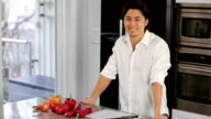 Attractive home chef making a healthy meal video