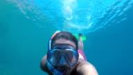 Attractive male diving into the mediterranean sea video