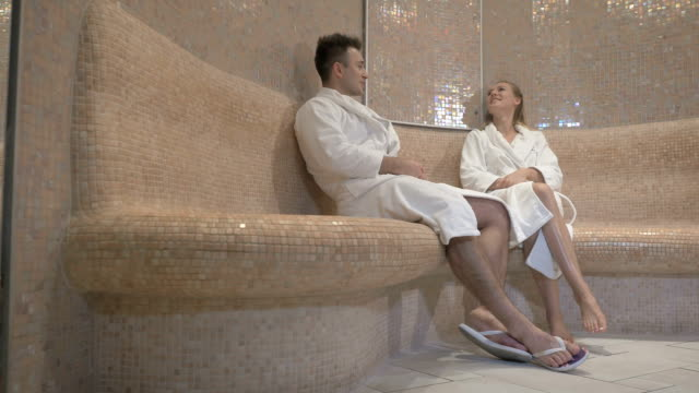 Attractive man and beautiful girl is relaxing after the sauna video