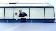 Attractive man playing a ping-pong at the court video