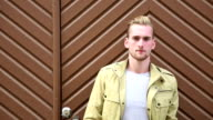 Attractive man standing outdoors video