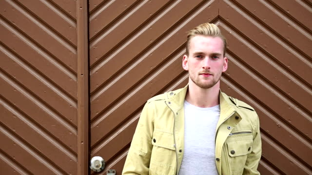 Attractive man standing outdoors video