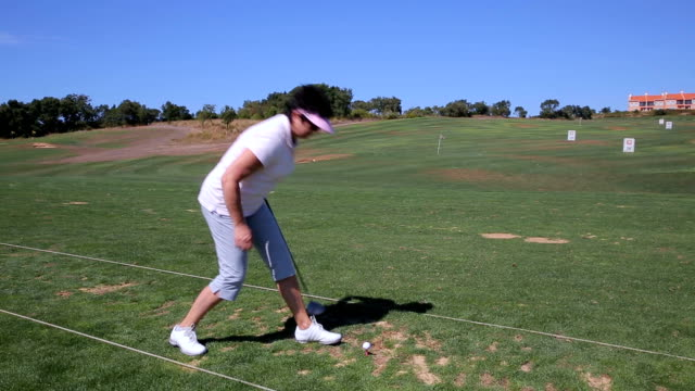 Attractive Mature woman plays Golf at the country club. video