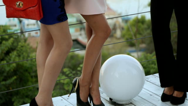 Attractive models in dresses posing on the outdoor terrace video