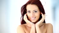 Attractive red haired woman in bathroom. video