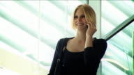 Attractive sexy businesswoman on mobile video