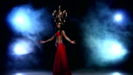 Attractive slim belly dancer go on dancing with candles, her head, black, smoke video