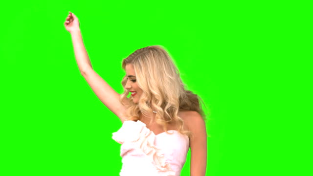Attractive woman dancing in wedding gown on green screen video