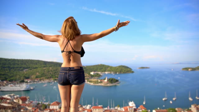 WS Attractive woman enjoying the sea breeze video