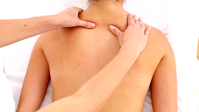 Attractive woman receiving back massage at spa center video