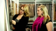 Attractive woman shopping in furniture store video