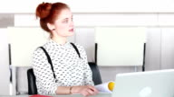 Attractive woman sitting at conference room, listening to presentation video