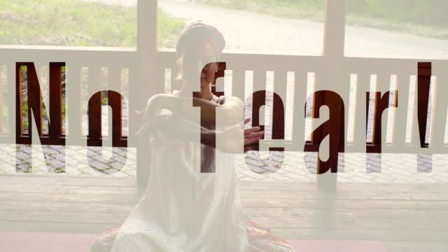 Attractive woman sitting on veranda in padmasana video