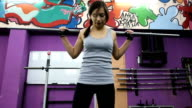 Attractive woman squats with a barbell video