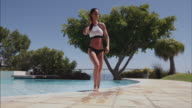 Attractive woman walking out of swimming pool video