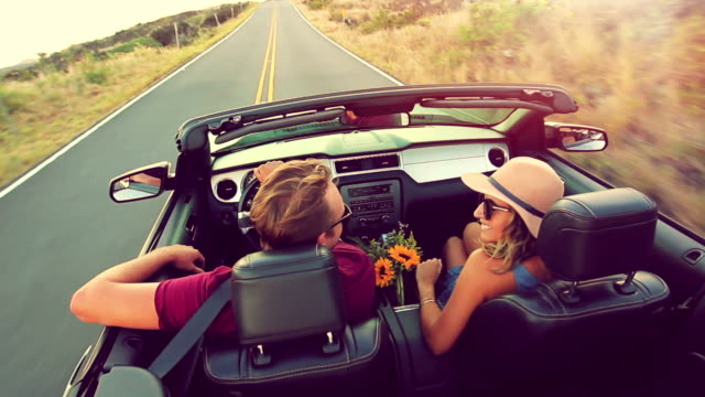 Attractive Young Couple Driving Convertible Car video