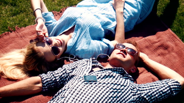 Attractive young couple relaxing in the summer sun video