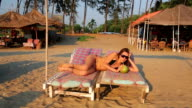 Attractive young woman on beach video