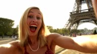 Attractive young woman takes selfie in Paris video